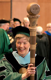 President Lou Anna K. Simon displays the University Mace at the 2005 Founders' Day Convocation.